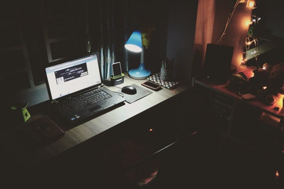 Black Laptop Beside Black Computer Mouse Inside Room · Free Stock Photo