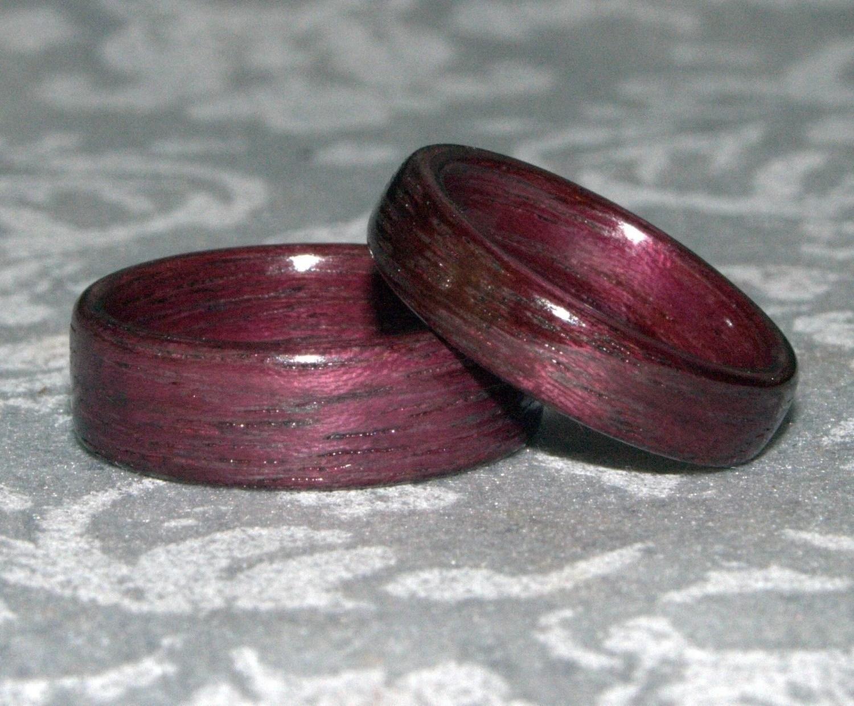set of wooden wedding rings purpleheart wooden wedding bands zoom