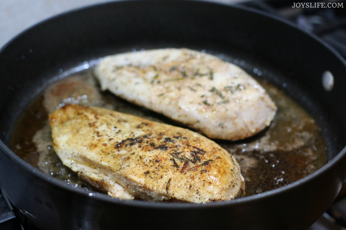 seared rosemary chicken in pan