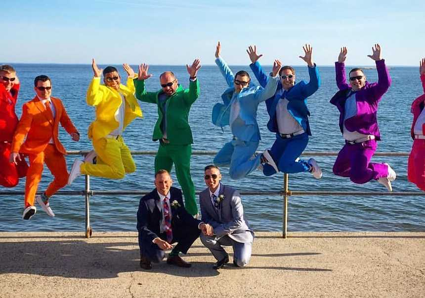 Grooms shocked by friends  epic rainbow suits for their wedding day     Grooms shocked by friends  epic rainbow suits for their wedding day     Love  What Matters