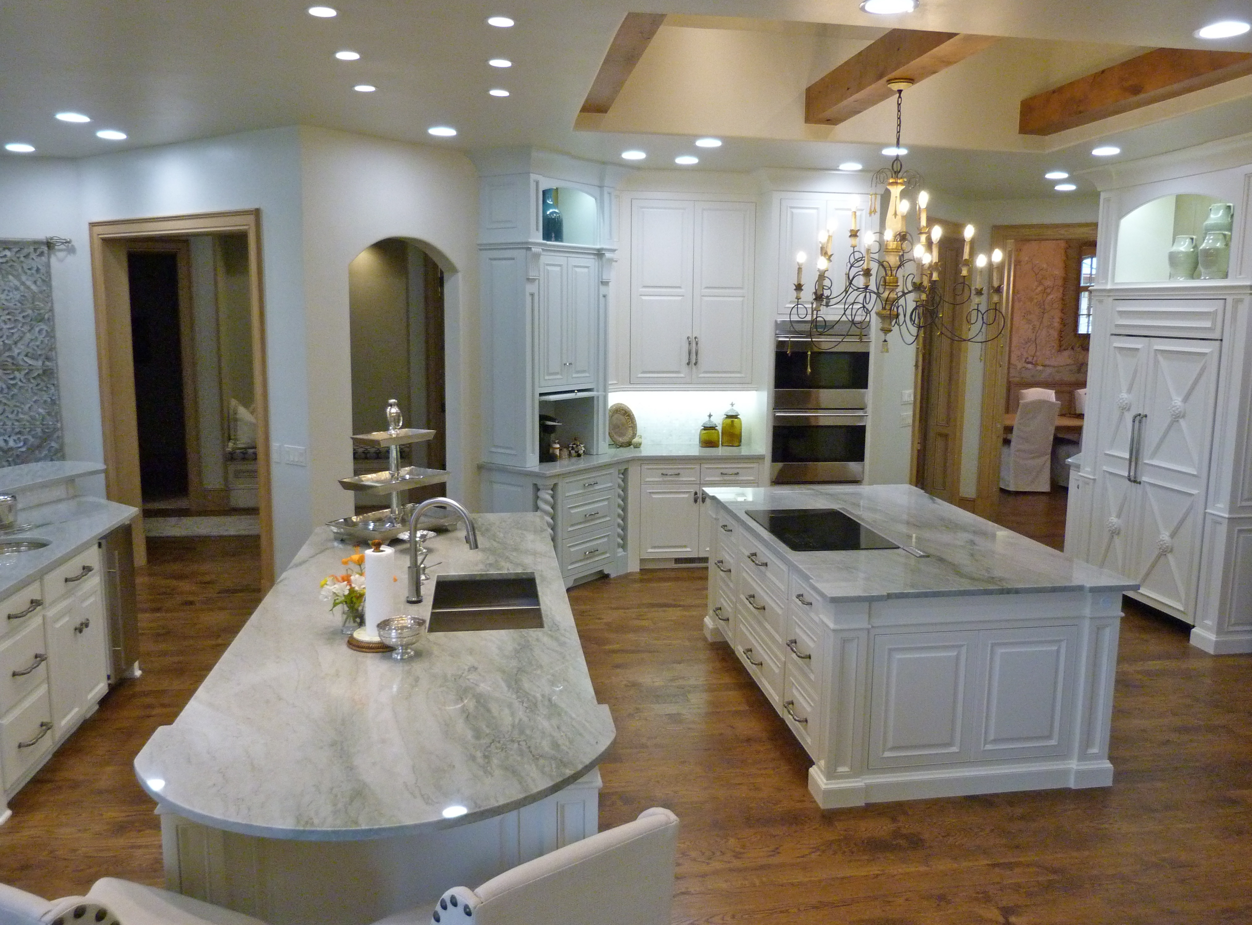 majesticconstructionok kitchen remodel okc Large kitchen with beams and three islands from Majestic Construction remodel