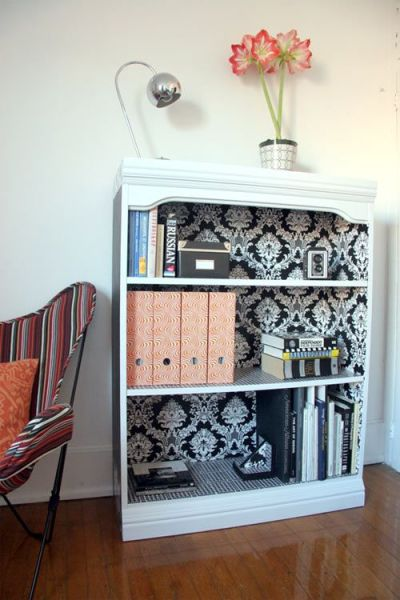 Bed Room Photos: wallpaper the inside of a bookshelf. This is on my to do list