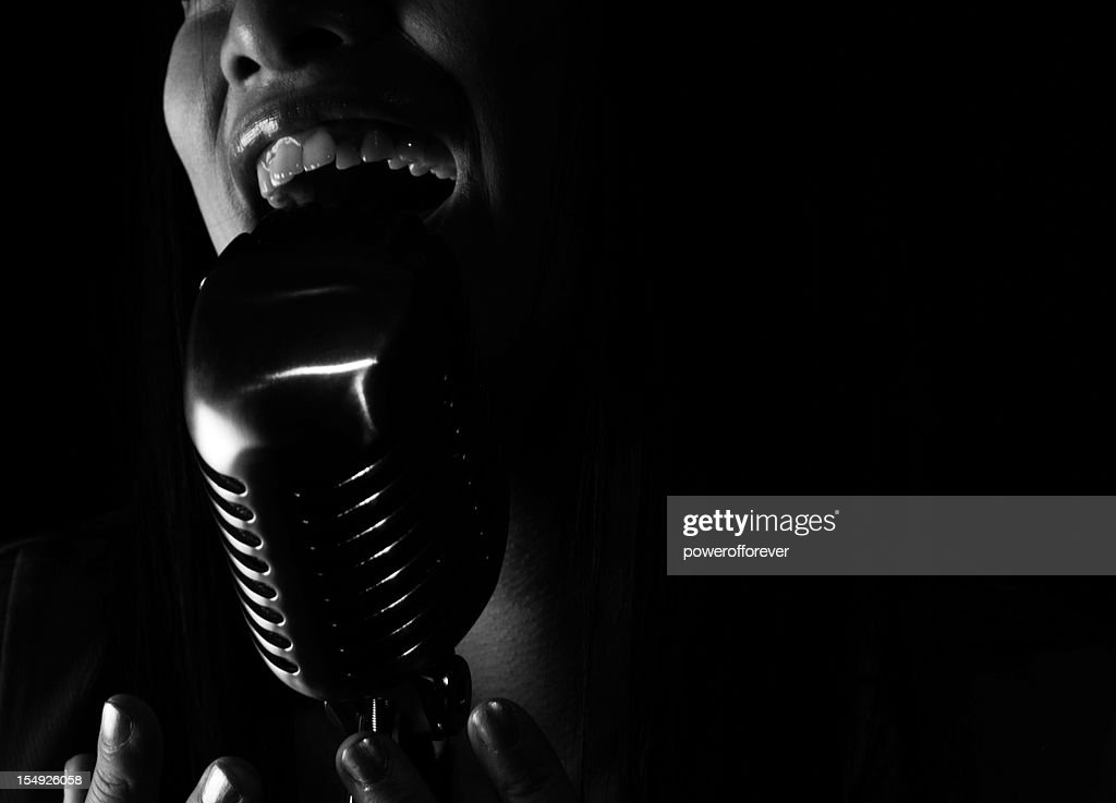Singer Stock Photos and Pictures   Getty Images Close up of jazz Singer singing into a microphone