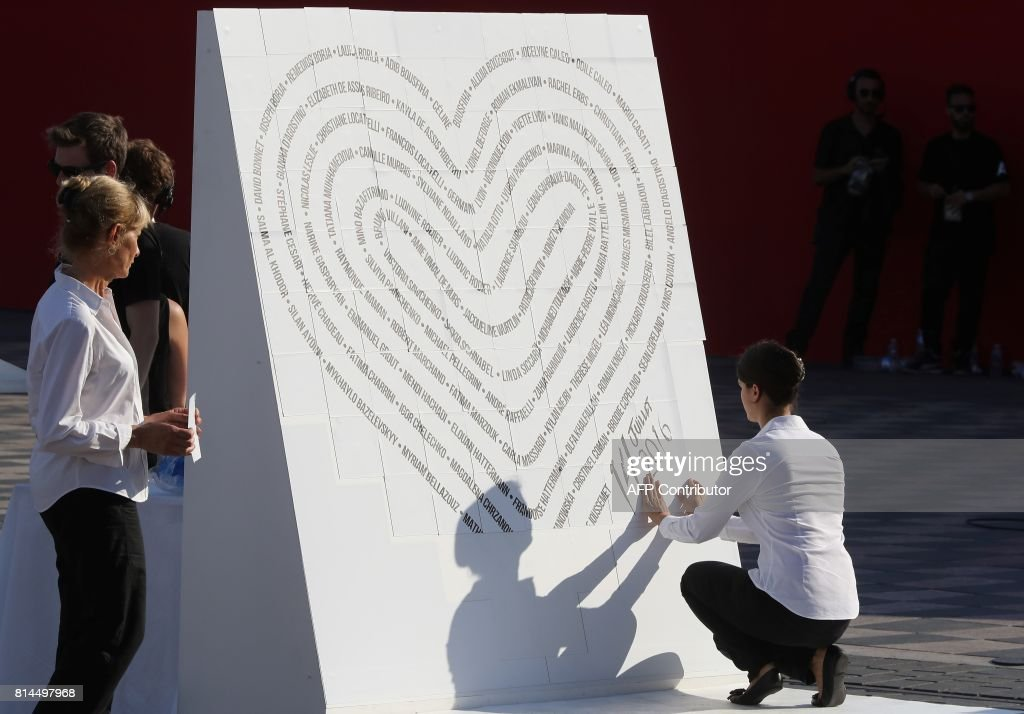 Participants create a heart with the names of the victims of the     Participants create a heart with the names of the victims of the 2016 Nice  terrorist attack