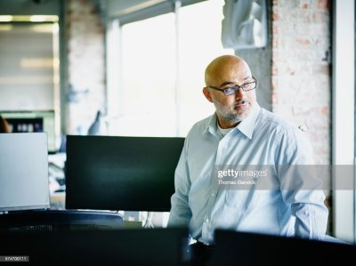 Small Business Owner Looking Out Office Window Stock Photo | Getty Images