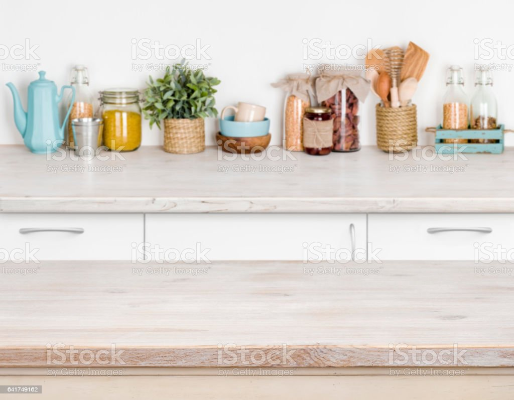 wooden kitchen table over blurred furniture shelf with food picture id641749162