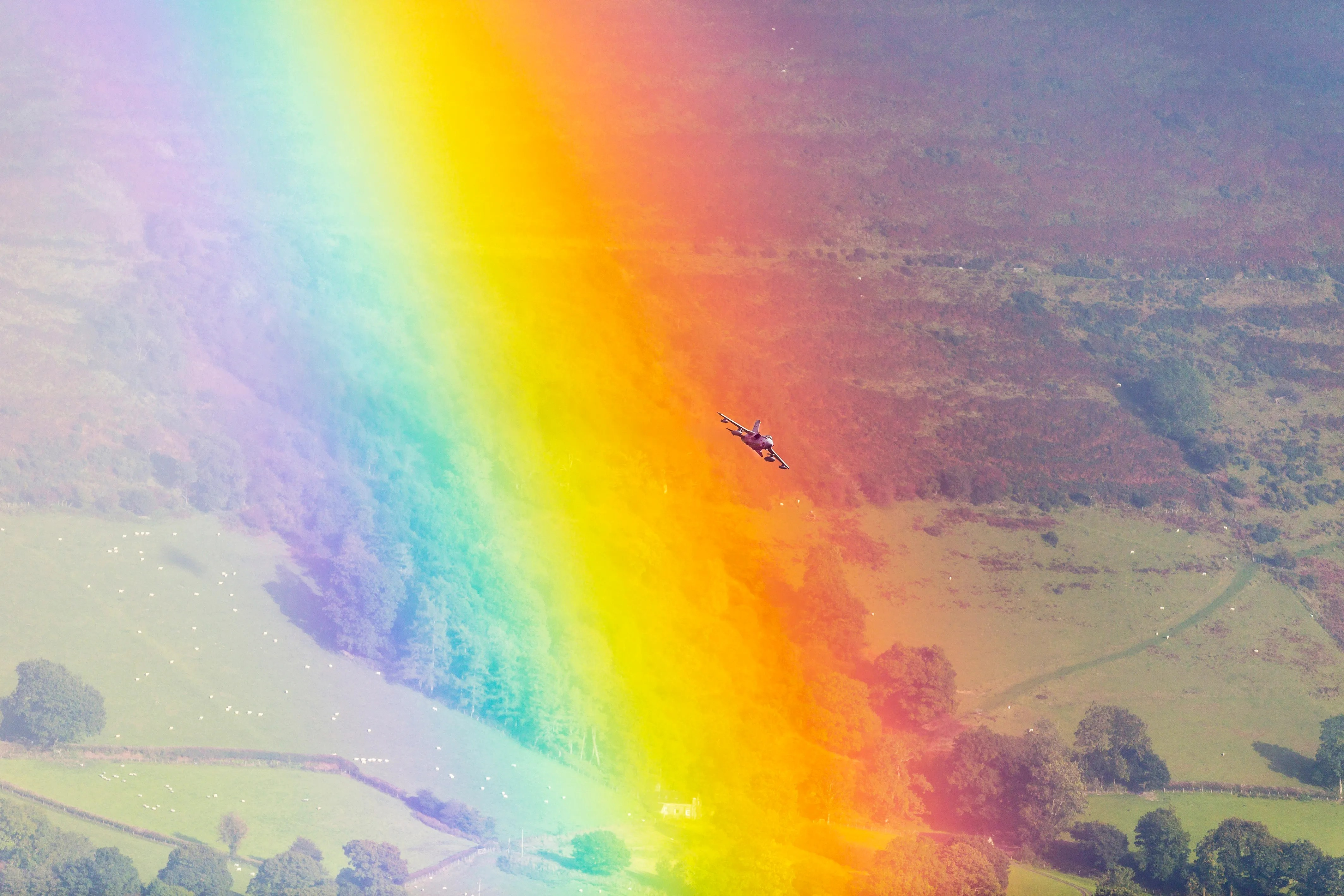 Wanna See a Fighter Jet Fly Through a Rainbow  Of Course You Do   WIRED A Royal Air Force GR4 Tornado soars through a rainbow in the Cambrian  Mountains  Wales