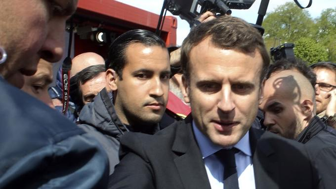 President Macron s bodyguard faces charges over beating allegations     Emmanuel Macron is flanked by his bodyguard  Alexandre Benalla  Photo   AP Press Association Images