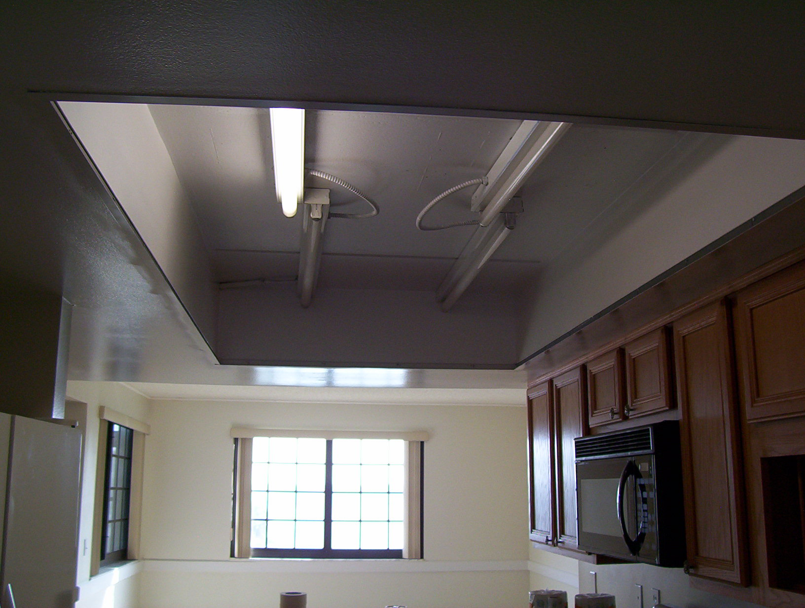 what to do with my old kitchen drop ceiling lighting kitchen ceiling lighting Cocoa Beach condo kitchen grid ceiling removed