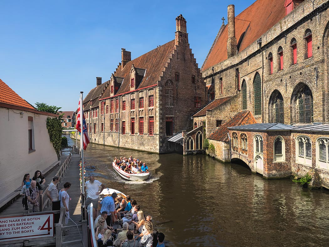 Boat Rides on the Historic Canals of Bruges  Belgium View down Bakkersrei Canal in Bruges  Belgium