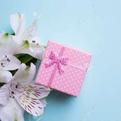 Pink Gift Box With Alstroemeria Flowers on Pastel Blue Background