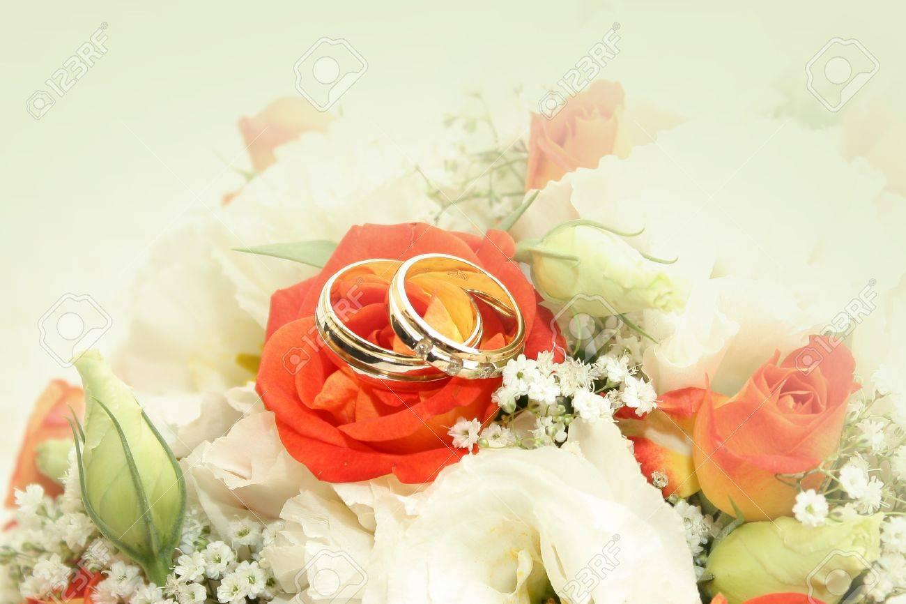 wedding rings orange flowers rocklands farm orange wedding rings Wedding rings and orange flowers at Rocklands Farm