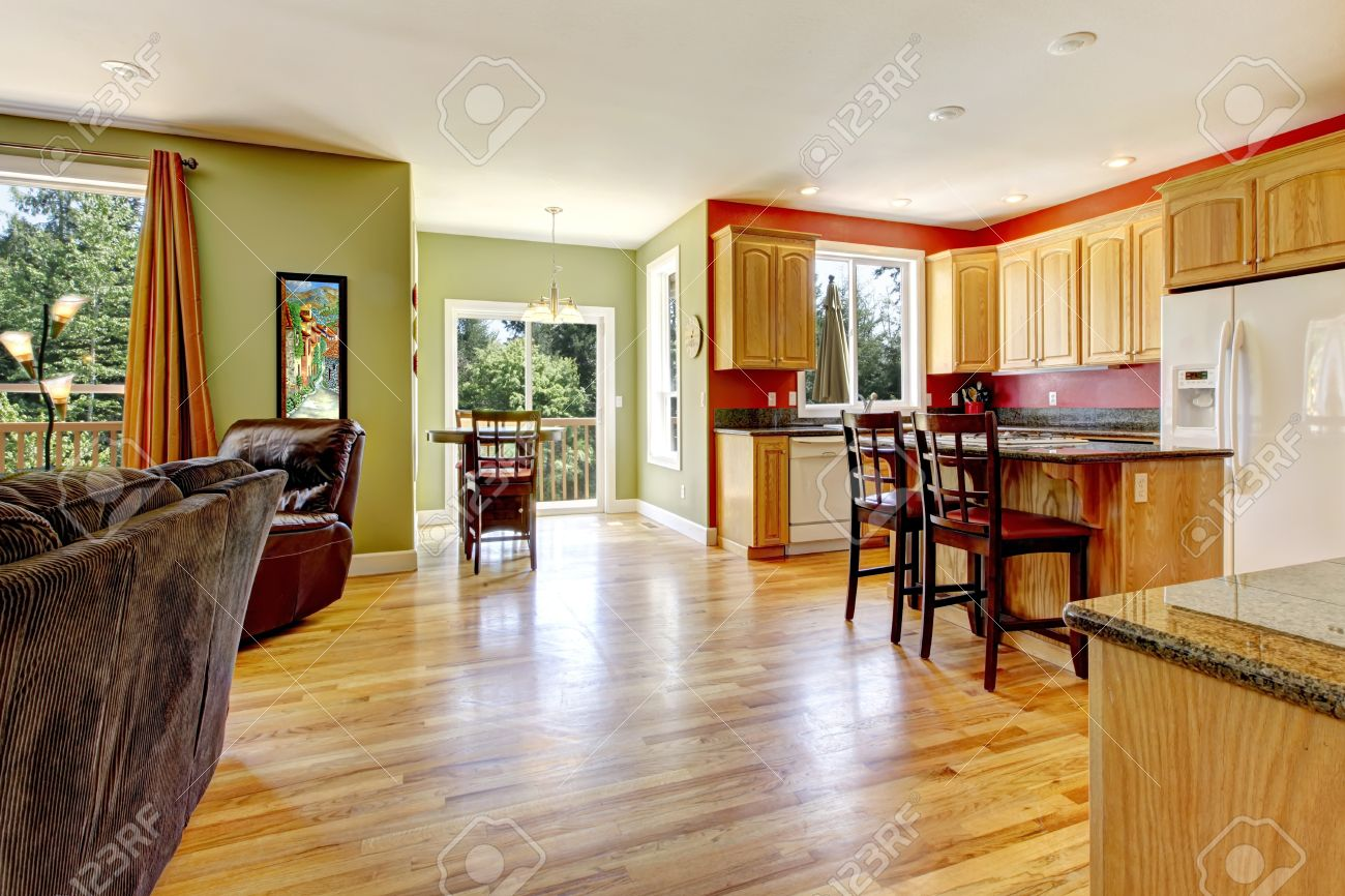 14615114 Kitchen with yellow wood floor and green wall near living room  Stock Photo