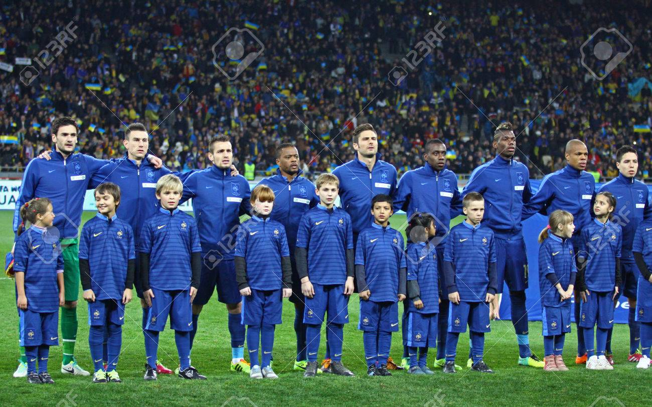 KYIV  UKRAINE   NOVEMBER 15  2013 France National Football Team     KYIV  UKRAINE   NOVEMBER 15  2013 France National football team players and  unidentified young