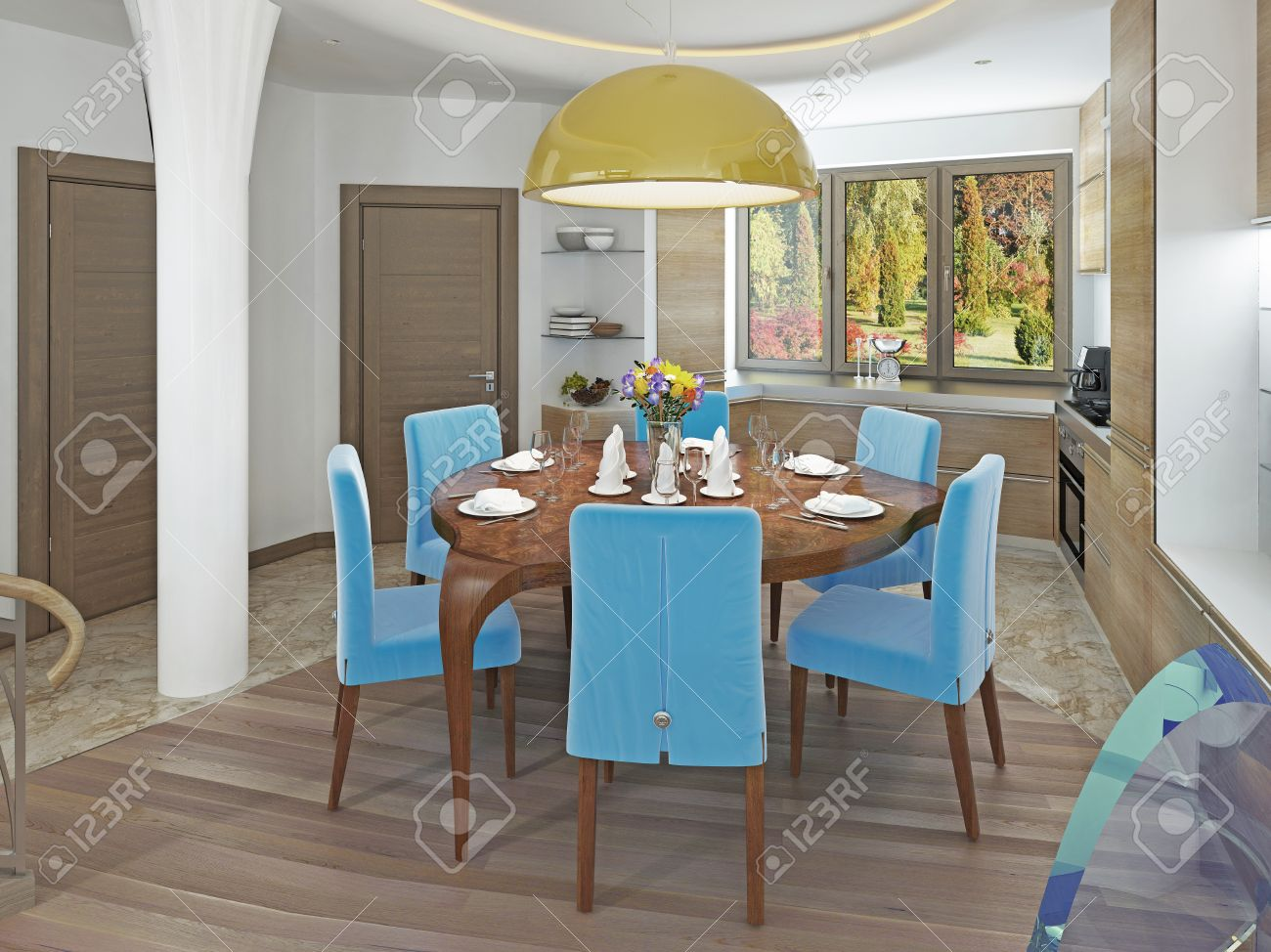 60565389 Modern dining room with kitchen in a trendy style kitsch Round dining table with comfortable blue ch Stock Photo
