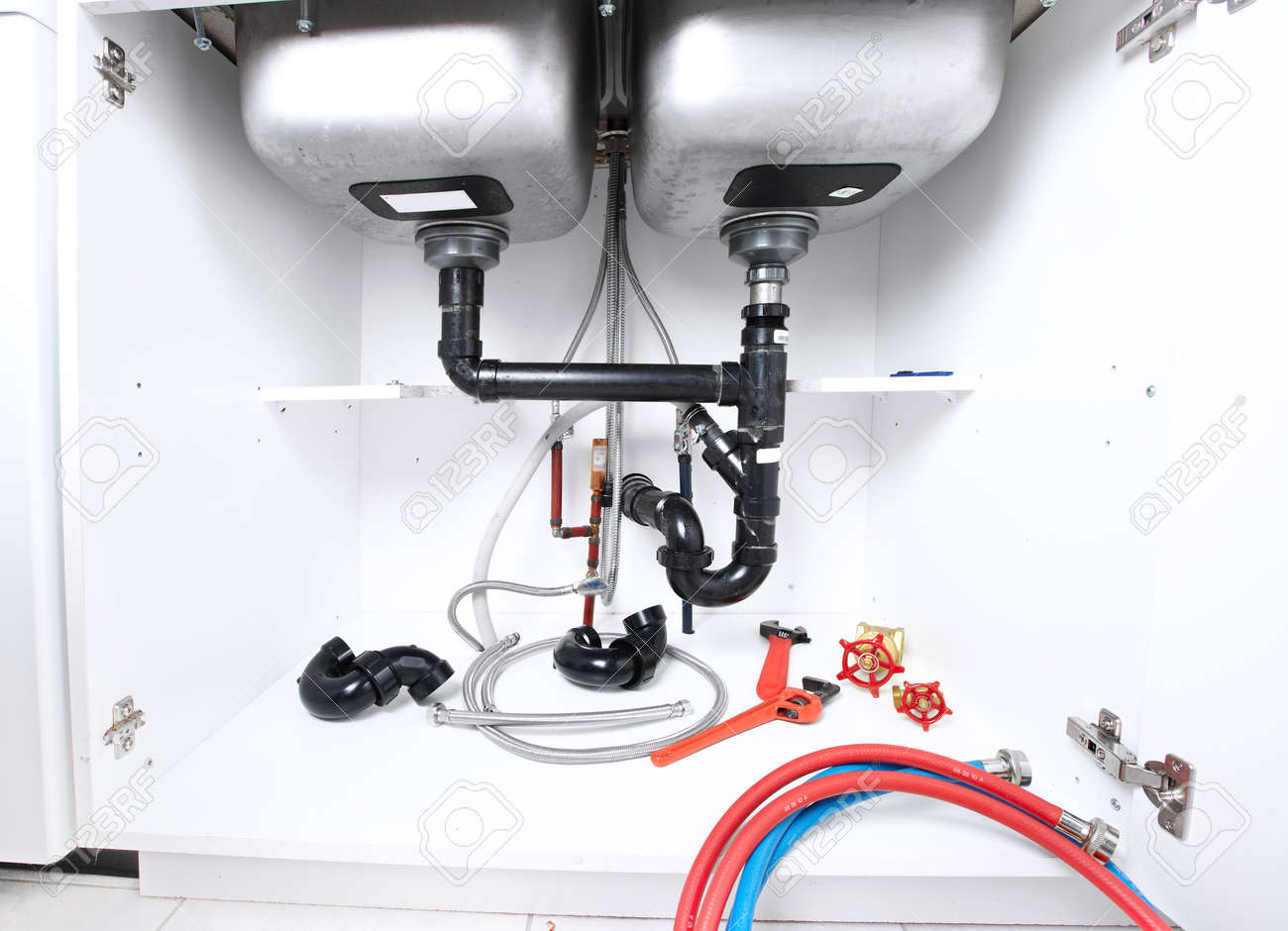 22871232 Kitchen sink pipes and drain Plumbing service  Stock Photo kitchen