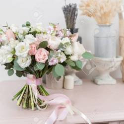 Beautiful Luxury Bouquet of Mixed Flowers on Pink Table the Stock