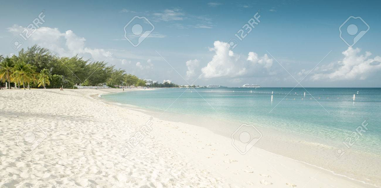 Panorama Of Seven Mile Beach On Grand Cayman Island Stock Photo     Panorama of Seven Mile Beach on Grand Cayman island Stock Photo   74953060