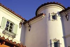 Spanish Mission house wrought iron, low pitched roof, arcaded porch with adjoining arches ...