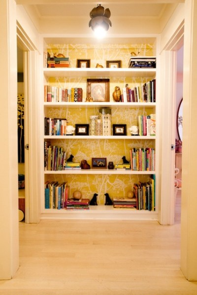A built-in bookcase with wallpapered back. I'm a complete ...