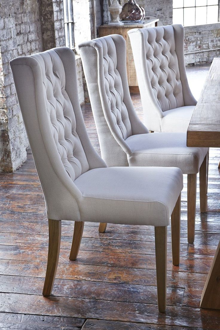 kitchen chairs kitchen chairs Upholstered winged chairs will give your dining room an air of elegance We love