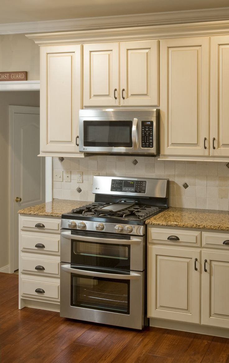 granite counters off white kitchen cabinets I like these cream cabinets I think I am looking for something more off white or cream in color for the cabinets I liked the microwave above the stove