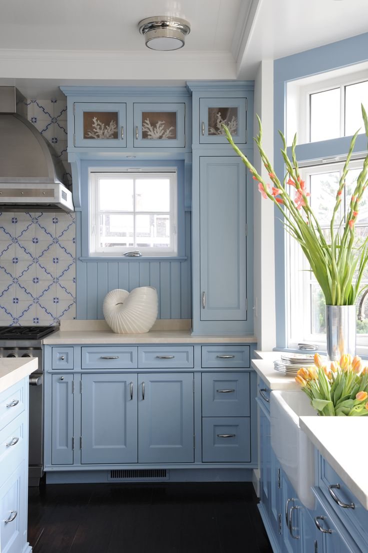 sweet blue cottage blue cabinets kitchen Antique tile backsplash love the blue color of the cabinets Photo by Stacy Bass