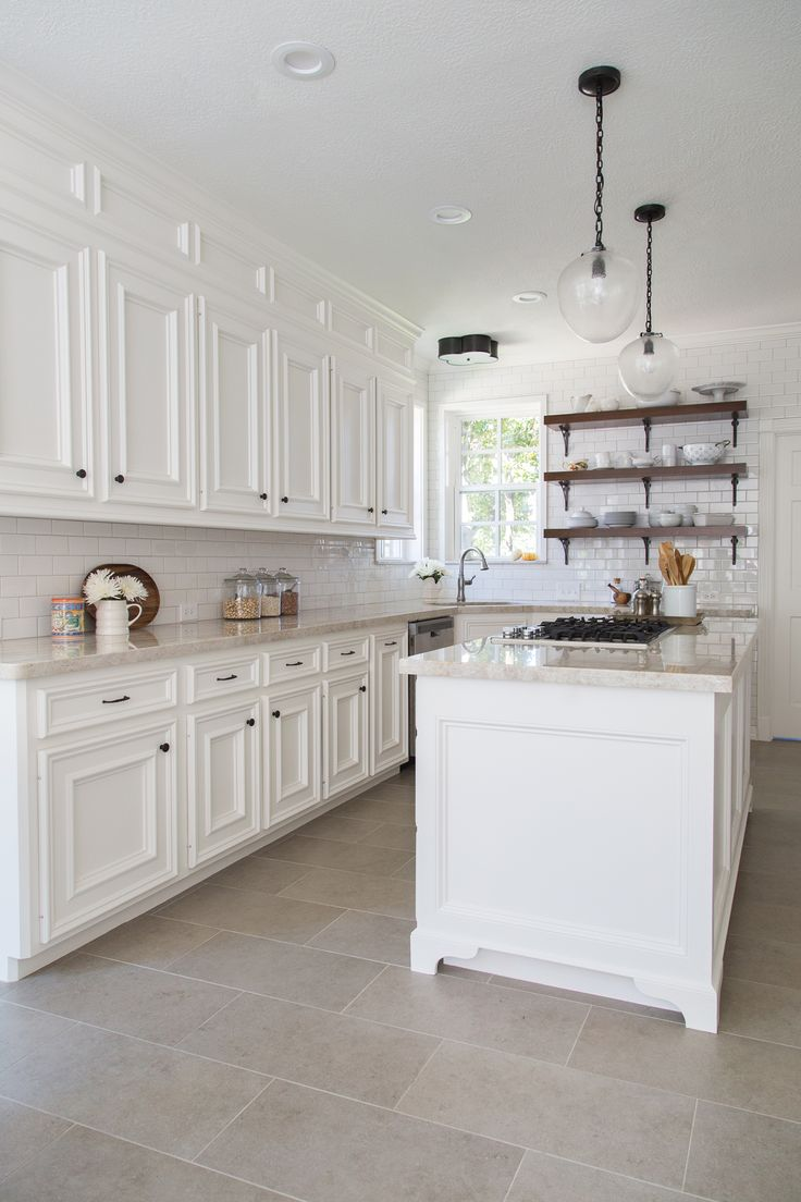 tile floor kitchen kitchen tile floor ideas BEFORE AFTER A Dark Dismal Kitchen Is Made Light And Bright Neutral Tile Floor