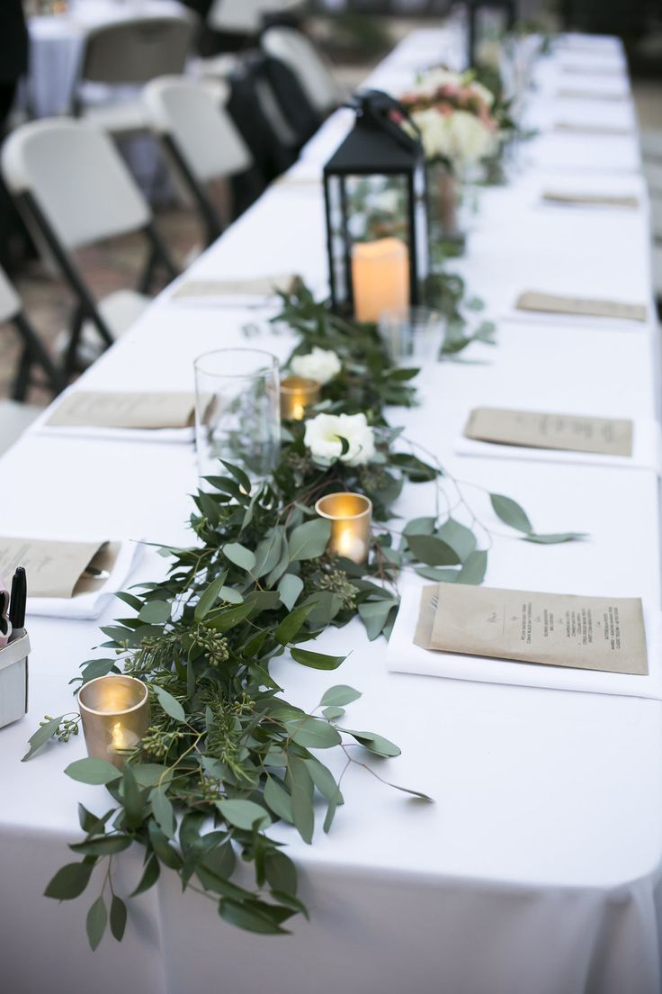 wedding table centerpieces wedding table centerpieces Ashly Evan Weddings in Tampa Bay Greenery garland down the head table made