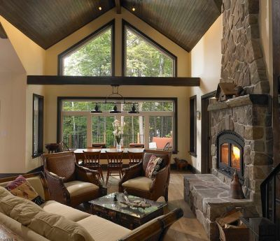 Living room with stone accent fireplace - by Lindal Cedar ...