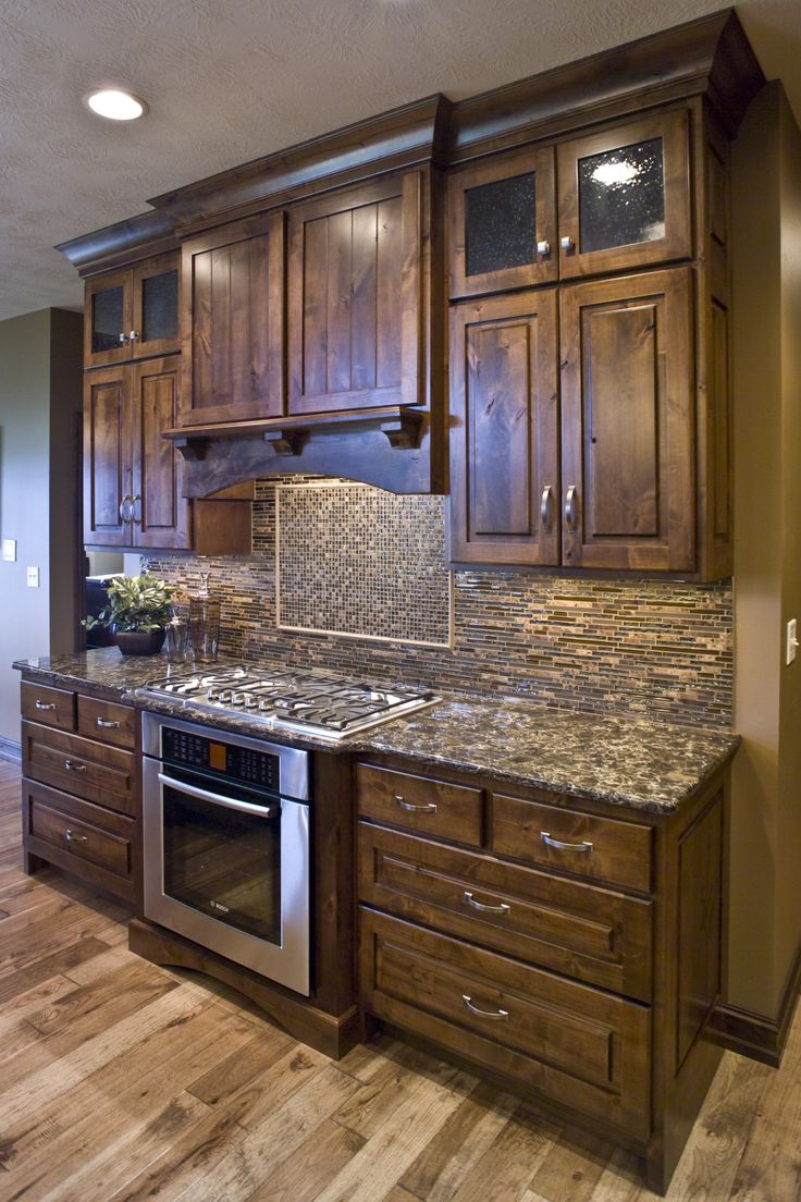 kitchens kitchen cabinet stain Like the tone of the Rustic Knotty Alder Kitchen Cabinets would prefer Shaker design Like the style of glass in the cabinet doors the covered hood