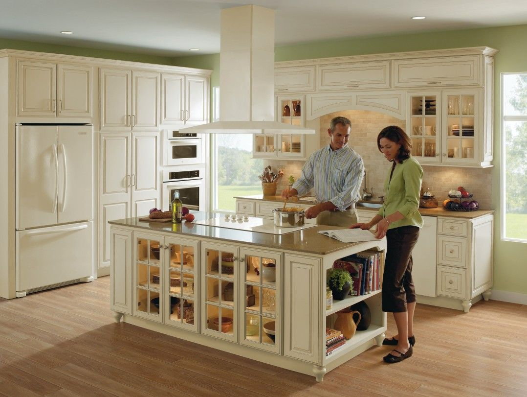 homecrest cabinetry beige kitchen cabinets Spacious kitchen in ivory with fawn glaze and beige granite against light oak wood flooring uses