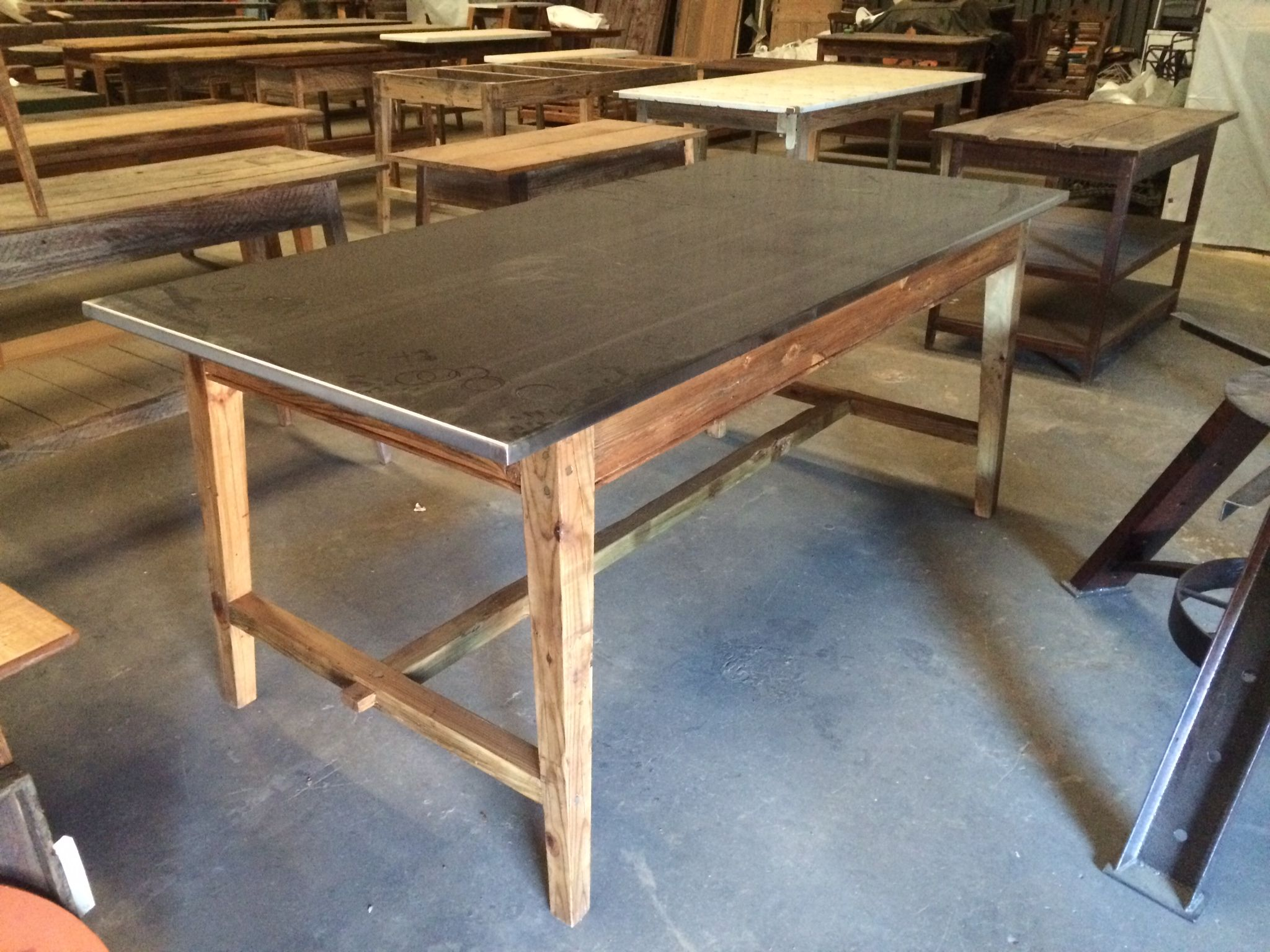 for the kitchen stainless steel kitchen table KItchen Island with stainless steel top Base made from old reclaimed wood by Landrum Tables