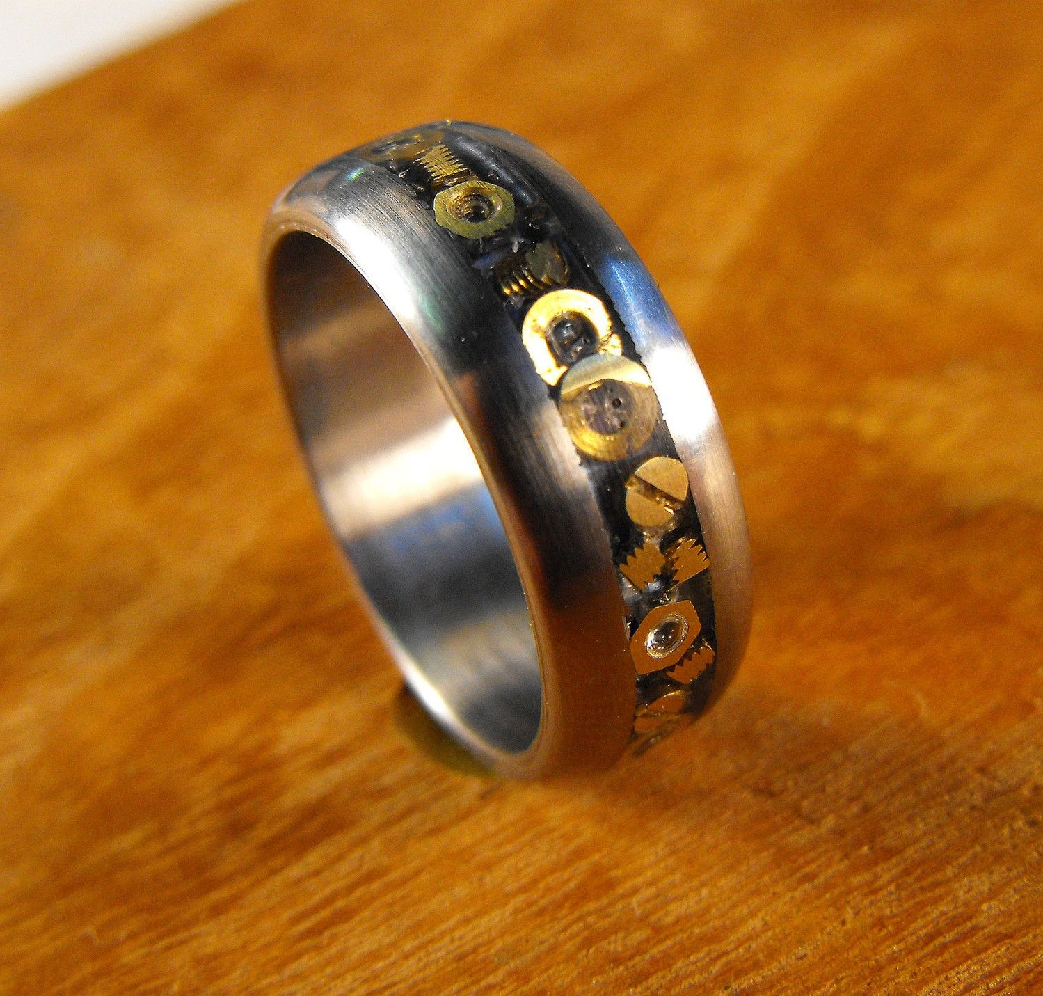 steampunk wedding rings Titanium Wedding Ring with Inlaid Hardware The Nuts and Bolts Ring