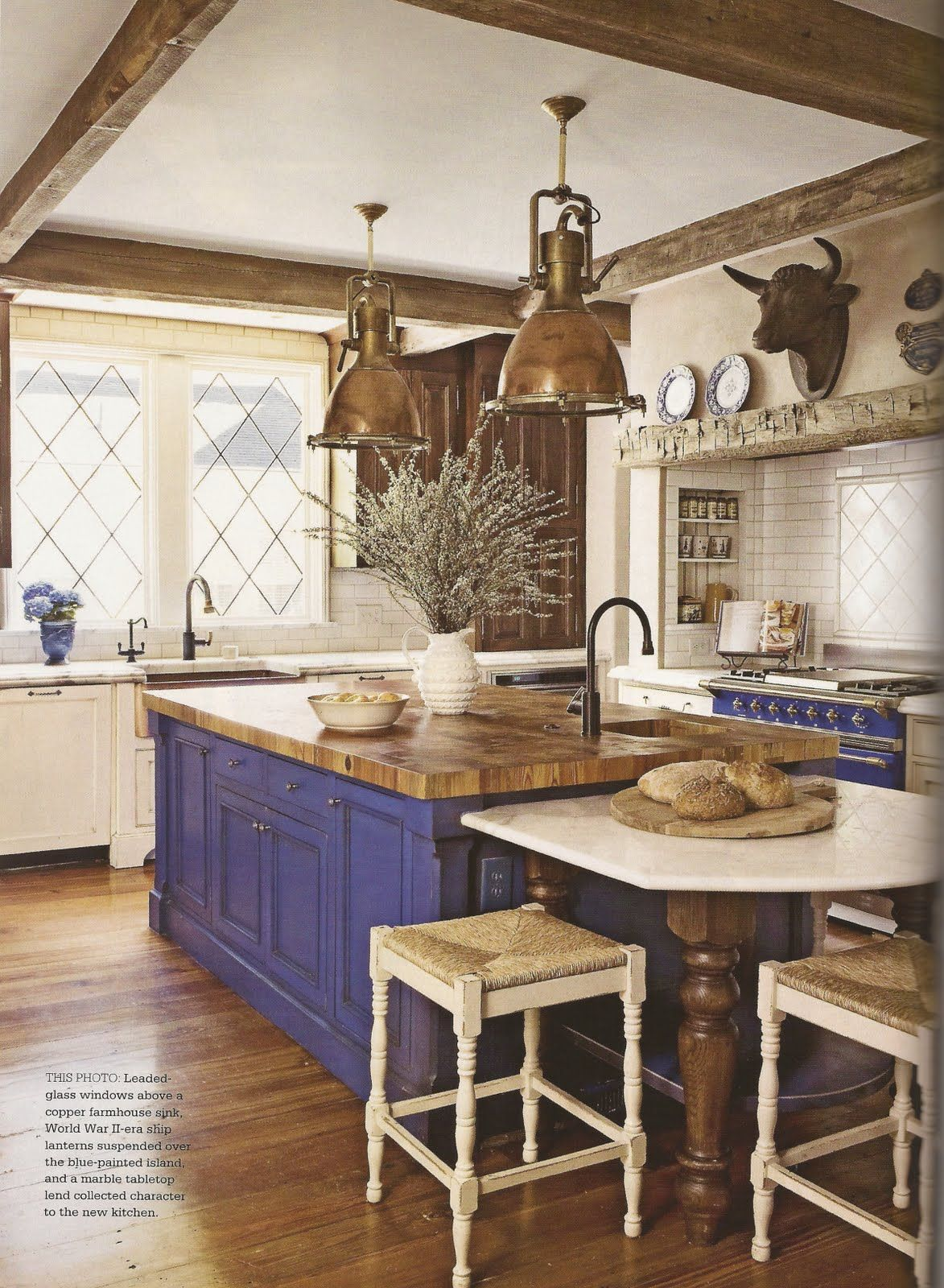 country kitchen lighting Blue island and oven in French Country kitchen This is so classic it transcends time