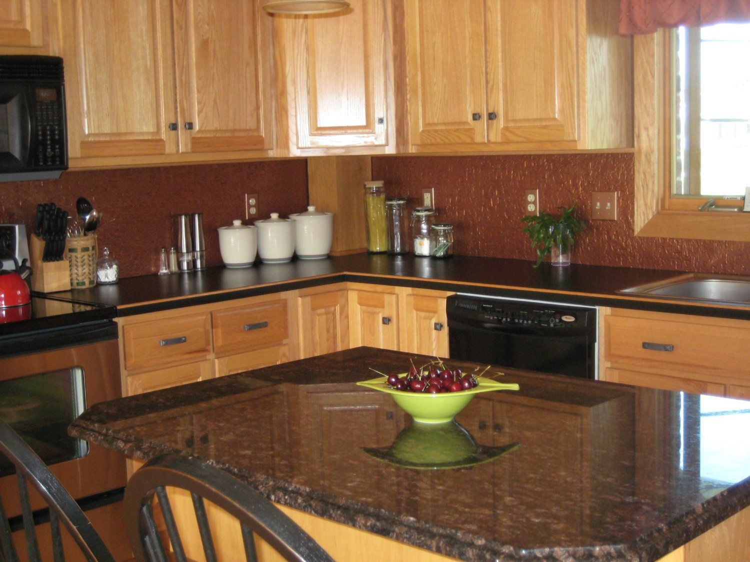dark granite countertops with light cabinets light kitchen cabinets images about kitchens on Pinterest Kitchen colors Wood cabinets and Backsplash for