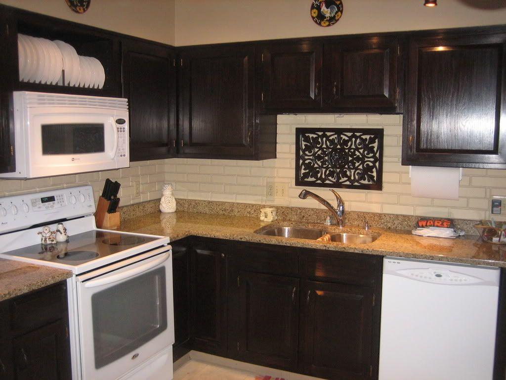 restaining kitchen cabinets a darker color restaining kitchen cabinets Java colored gel stain over orange s oak cabinets Cabinets BestkitchencabinetsStaining Kitchen