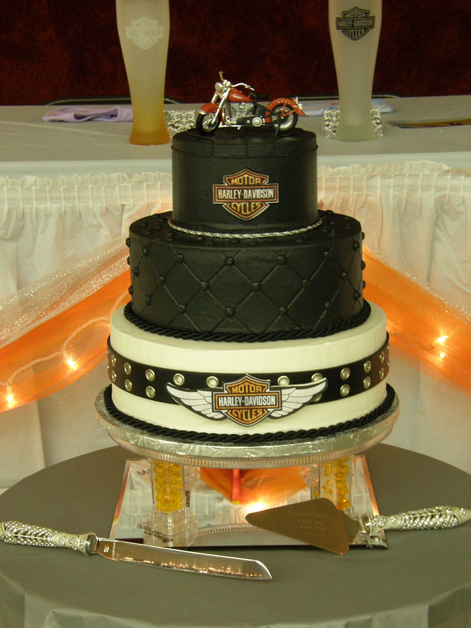 harley davidson wedding rings tiers stacked All buttercream Harley logos are printed from computer and glued to gumpaste cutouts with piping gel Top tier has piping to look like
