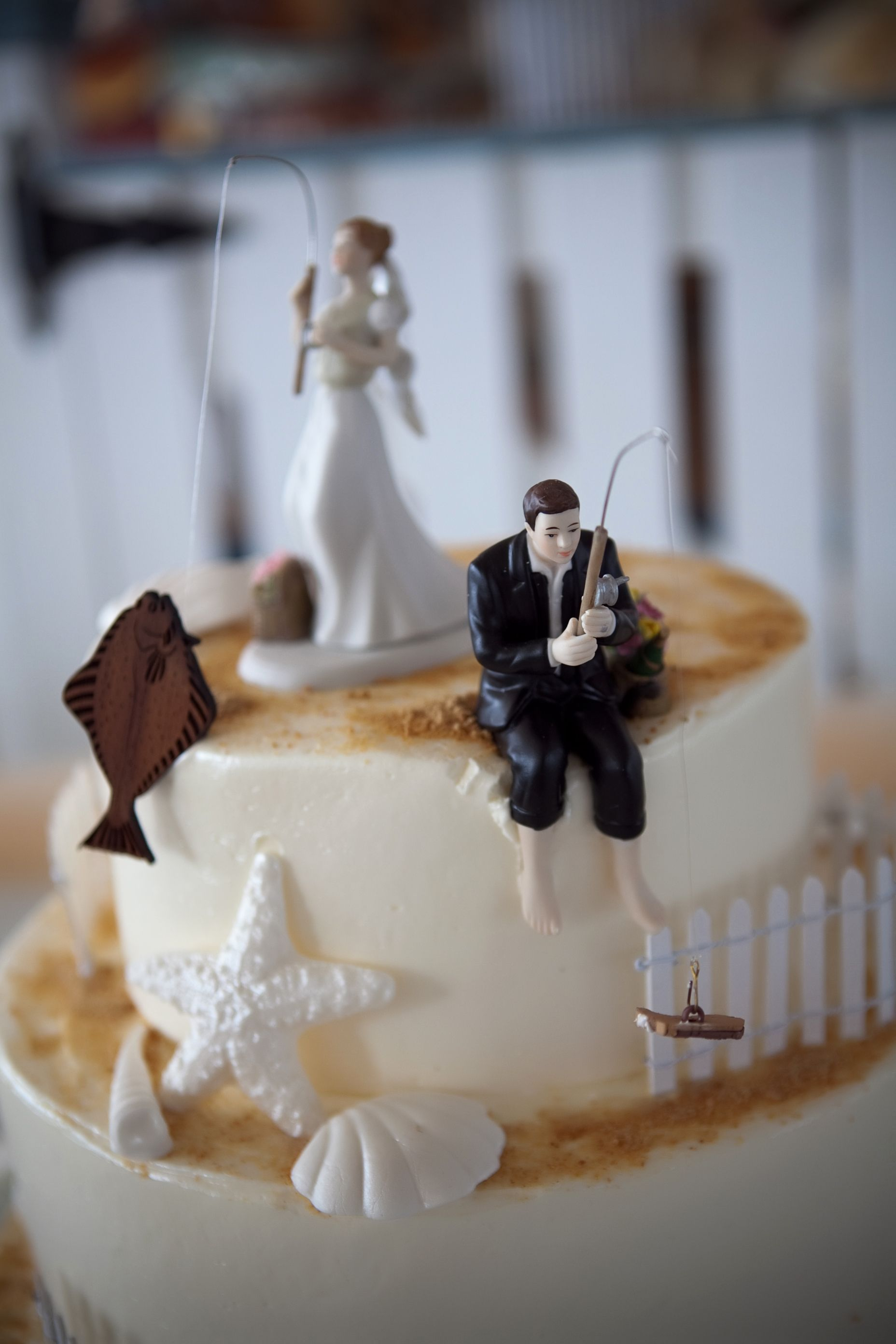 wedding cake toppers funny Fishing Cake toppers from our wedding bride with halibut and groom with boot