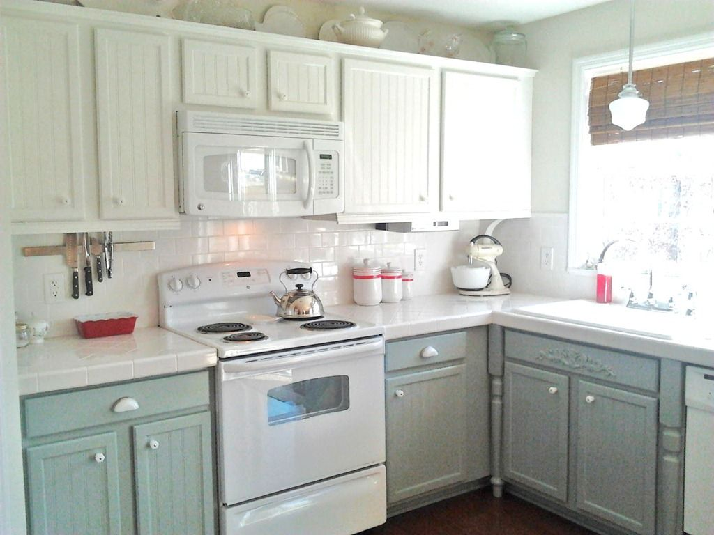 white cabinet kitchen Kitchen cabinets I like this with the white tops white backsplash and the grey bottoms