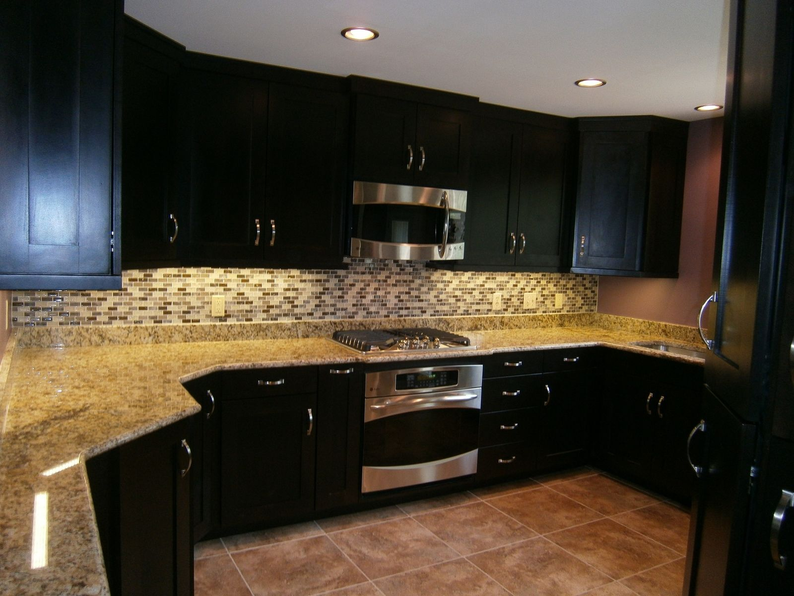 kitchen cabinet stain Excellent White Gray Glass Tile Backsplash And Brown Mosaic Granite Countertop As Well As Cool Espresso Kitchen Cabinets And Microwave Shelves And Ceiling