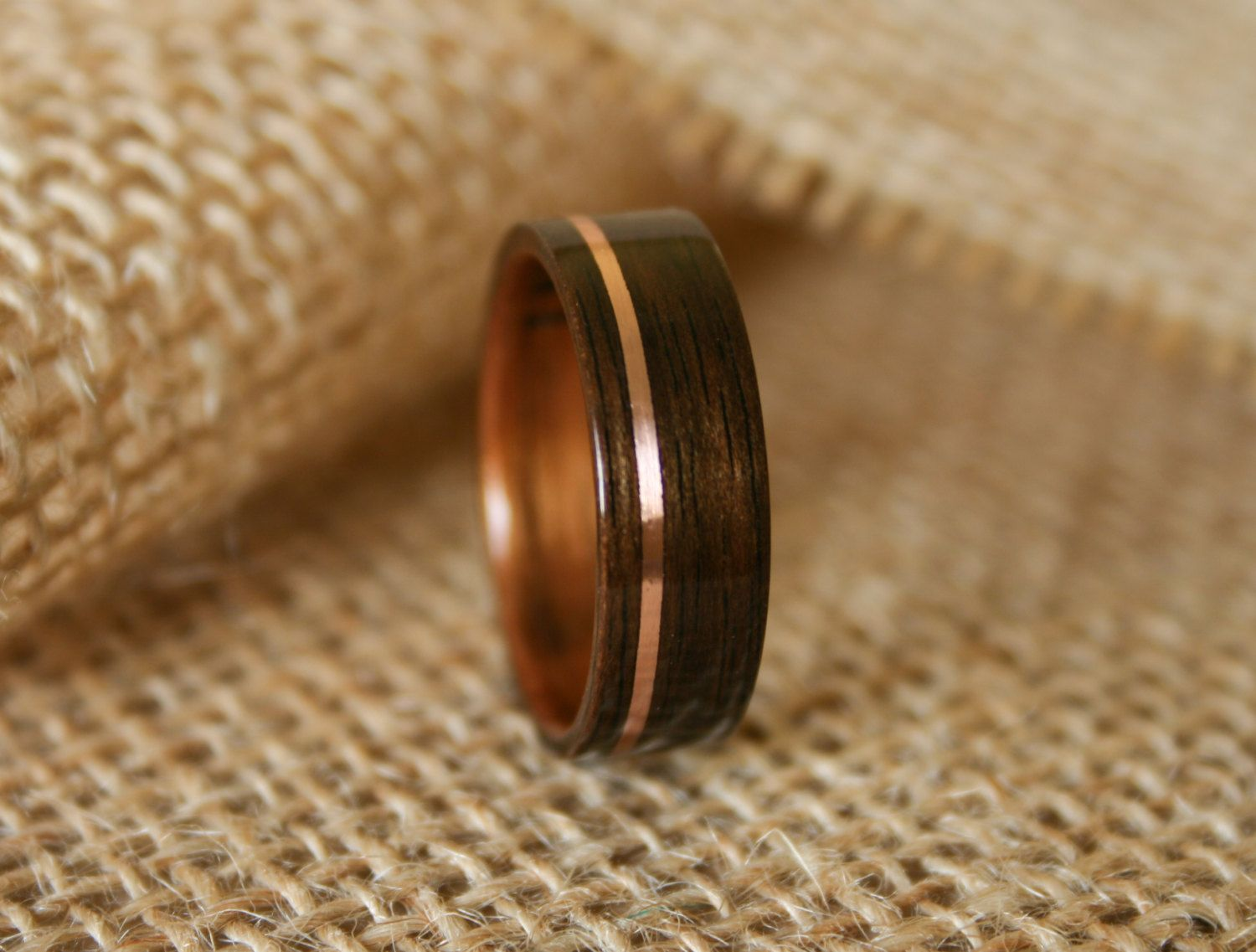 mens wooden wedding bands koa wedding bands Men s Wooden Wedding Band with 14k Rose Gold Inlay in Macassar Ebony Wood with Koa Wood