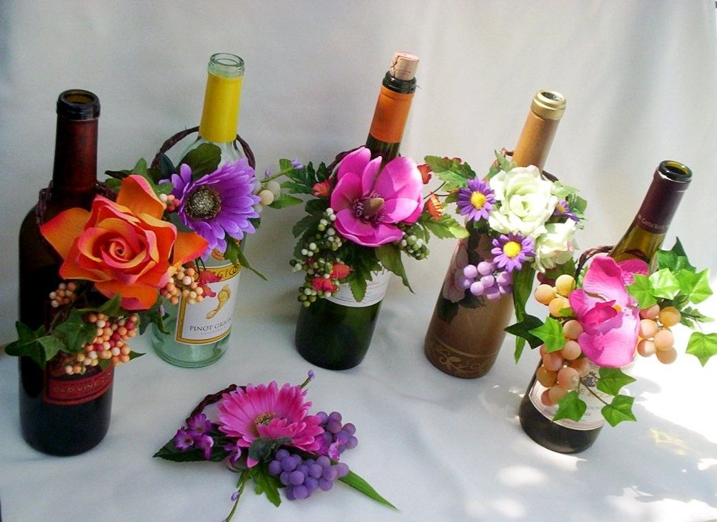 centerpieces for wedding Tropical Wedding Reception Wine Bottle Centerpieces 10 95 via Etsy