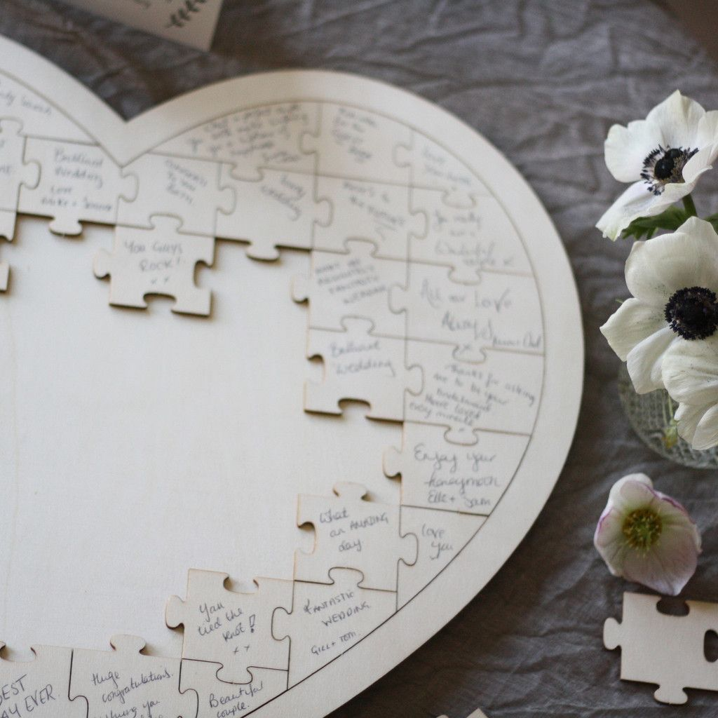 wedding books Wooden heart jigsaw puzzle wedding guest book available to buy from theweddingomd