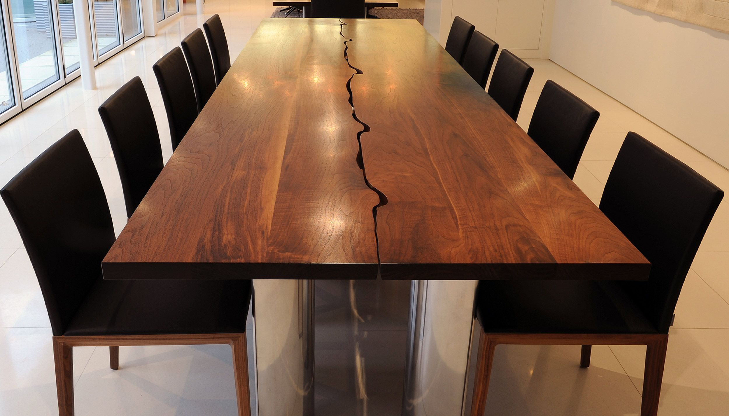 wooden kitchen table Round Modern Dining Table And Large Brown Glaze Teak Wood Dining Table With Stainless Steel Based Legs Combined With Black Suede Fabric Armless Chairs Also