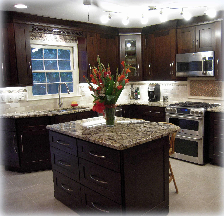 backsplash lighting under cabinet kitchen lighting Backsplash Tiles Completed Kitchen Mocha Maple Shaker Cabinets Exotic Granite Countertops Track Lighting And Under Cabinet Lighting
