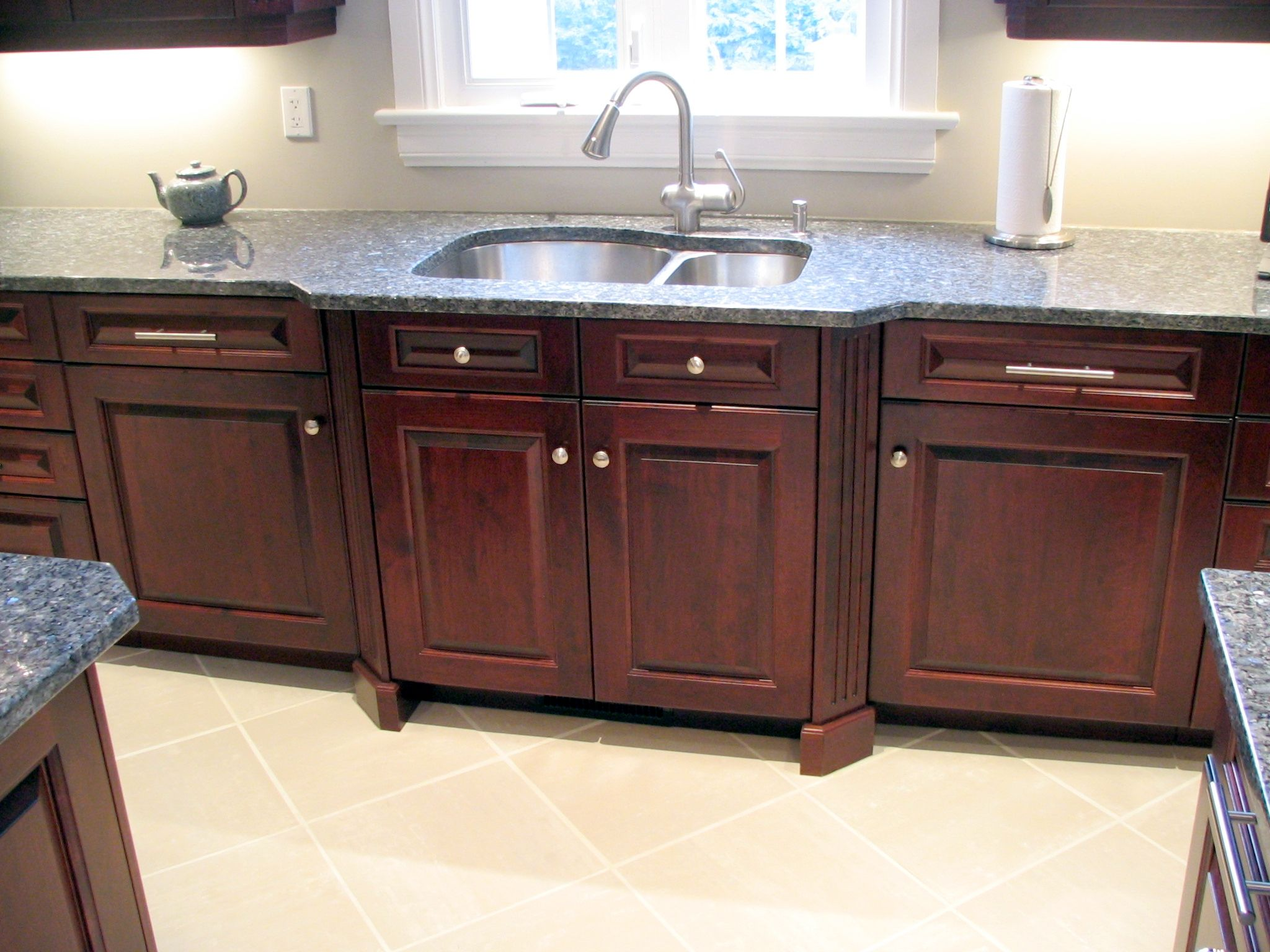 cabinet connection kitchens kitchen sink cabinets Angled fluted columns bump out the sink area in this Rosewood Cherry kitchen Can you
