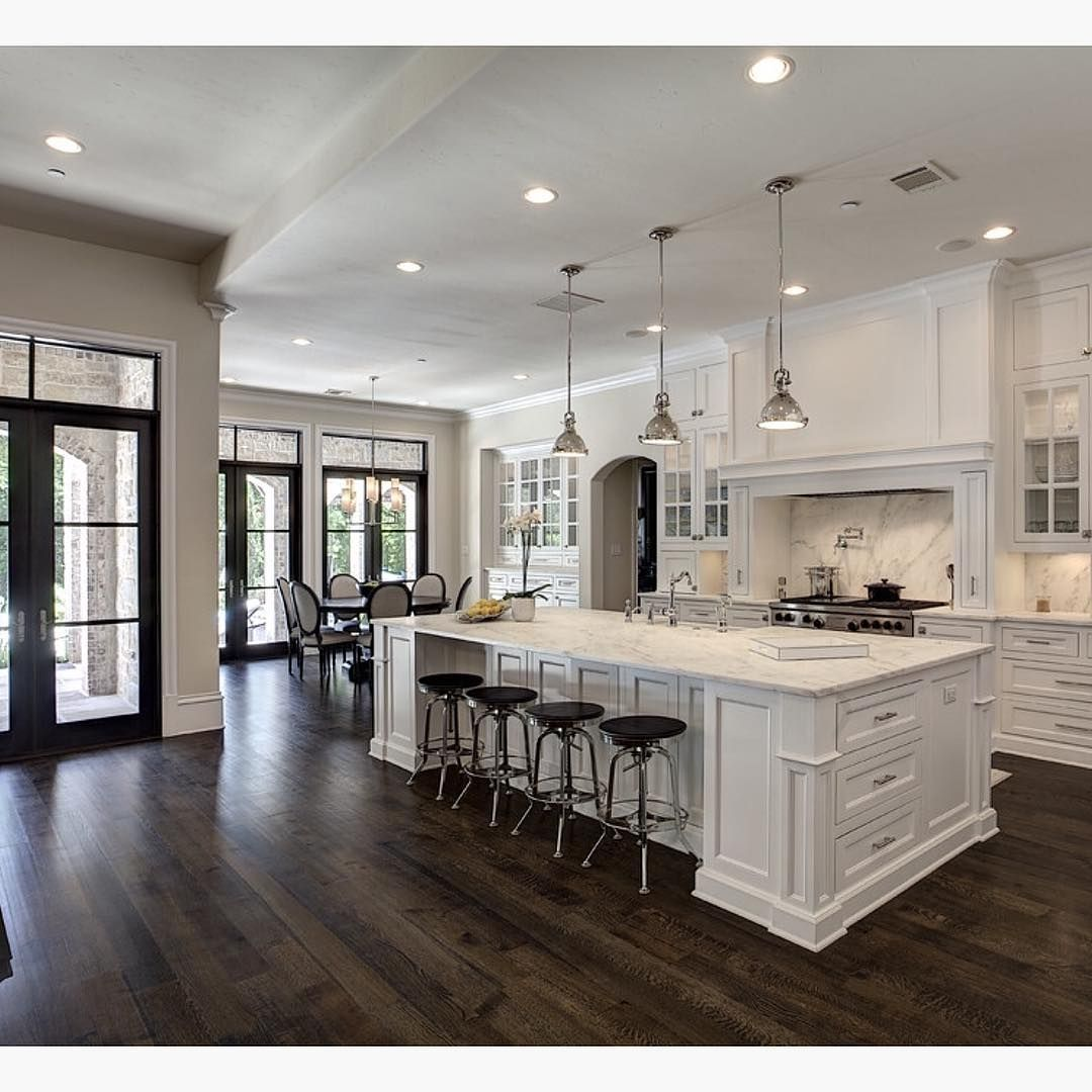 wood floors in kitchen Love the contrast of white and dark wood floors By Simmons Estate Homes