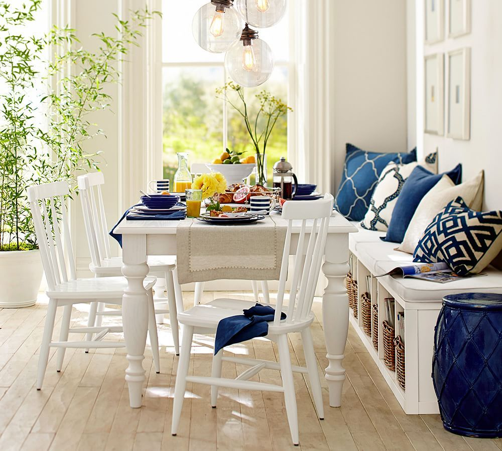 small white kitchen table Think casual for small dining spaces a bench on the side of this all