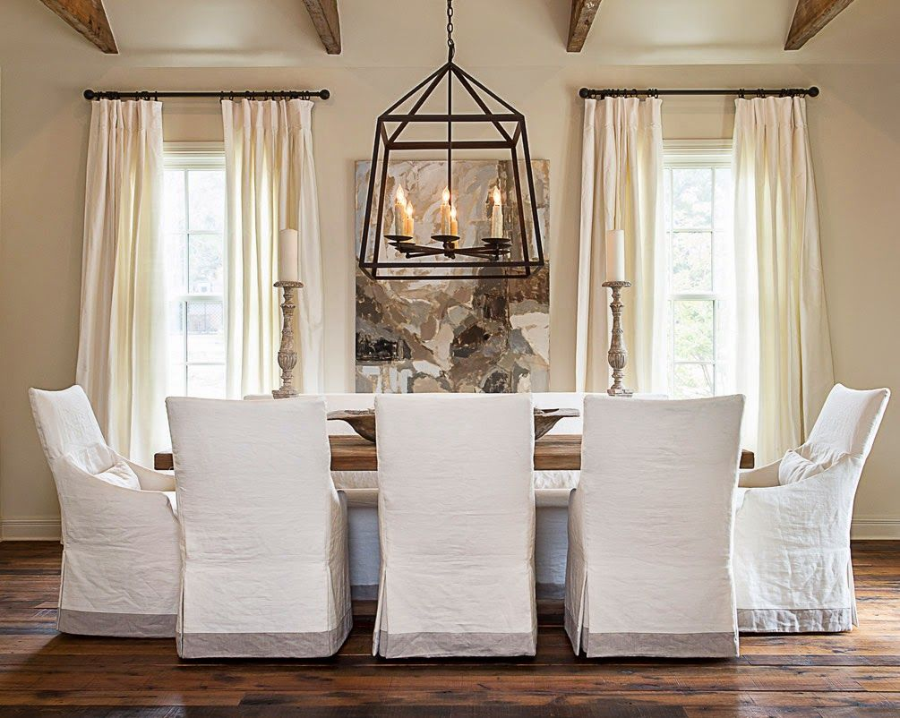 dining room chair slipcovers kitchen chairs with arms Like the clean look of the white slipcovered dining chairs combined with the strength of the large black pendant light